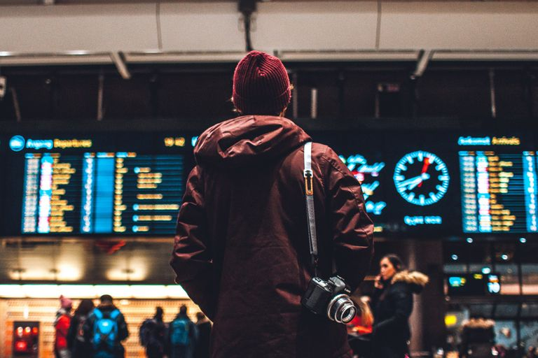 Man looking at the departures board at Oslo central station